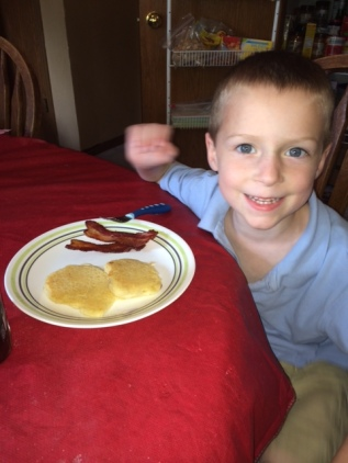 Joel eating yummy gluten and dairy free pancakes!
